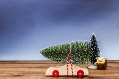 Wooden car with christmas tree Royalty Free Stock Images