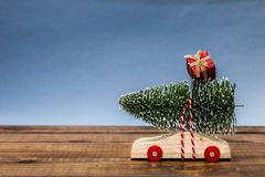 Wooden car with christmas tree and gift box Royalty Free Stock Image