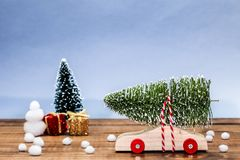 Wooden car with christmas tree and gift boxes Royalty Free Stock Image