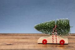 Wooden car with Christmas tree Royalty Free Stock Image