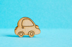 Wooden car icon on blue background.  Royalty Free Stock Image