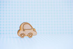 Wooden car icon on blue checkered background. Concept of moving. Symbol of traveling Stock Photography