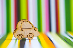 Wooden car icon on colorful striped background. Concept of moving. Symbol of traveling royalty free stock photos