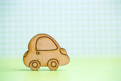 Wooden car icon on green checkered background. Concept of moving. Symbol of traveling Royalty Free Stock Photo