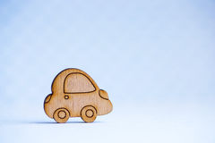 Wooden car icon on light gray background Royalty Free Stock Photos