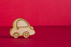 Wooden car icon on red background Stock Photography