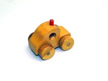 Wooden car rear-view. Wooden toy car, rear-view, on white background Royalty Free Stock Photos