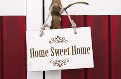 Wooden card board with home sweet home royalty free stock photos