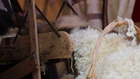 wooden carder and raw wool stock footage