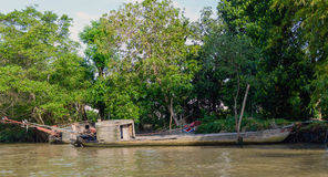 Wooden cargo boat on the Mekong River Delta stock photos