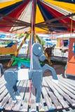 Wooden Carousel Martinique pier entertainment. Horse on wooden Carousel - Martinique pier carnival Stock Photo