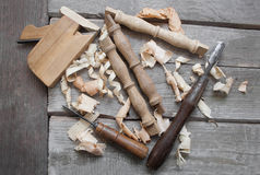Wooden carpenter table carved elements with instruments Stock Photos