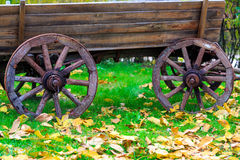 Wooden carriage in autumn park Royalty Free Stock Images