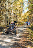Wooden carriage with people on fall background Royalty Free Stock Images