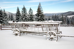Wooden carriage in snow Royalty Free Stock Photography