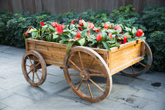 The wooden cart, flowers Stock Photo