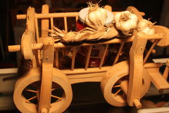 Wooden cart with garlic Royalty Free Stock Image