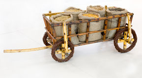 Wooden cart with grains in sacks Stock Image
