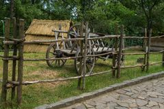 Wooden cart with the same wooden wheels. And with the fifth zapaska royalty free stock photo