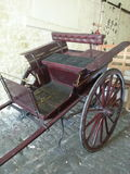 Wooden cart, trap or carriage. Painted old wooden carriage or trap Stock Photo