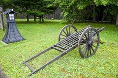 Wooden cart wagon on green field. 1 Stock Photo