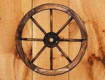 Wooden Cart Wheel. With spikes stock photography
