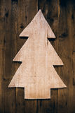 Wooden carved christmas tree for a xmas background. Stock Photography