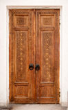 Wooden carved door Royalty Free Stock Image