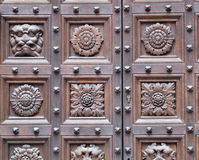 Wooden carved door close-up. Close-up on wooden decorative door elements (Italian baroque architectural art Stock Images