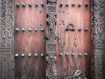 Wooden carved door in Stone Town, Zanzibar. Horizontal photo of old traditional wooden carved door in Stone Town, Zanzibar, Tanzania, East Africa, close up royalty free stock photos