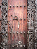 Wooden carved door in Stone Town, Zanzibar Royalty Free Stock Photo