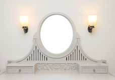 Wooden carved dressing table with blank frame in room Stock Image