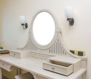 Wooden carved dressing table with blank frame in room Royalty Free Stock Photography