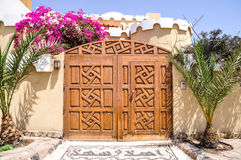 Wooden carved gate. Fragment of house with carved wooden gate Royalty Free Stock Photos