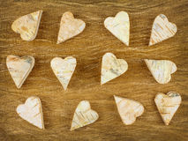 Wooden carved hearts on a retro wooden background Stock Photo