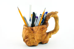 Wooden carved mug with pencils Royalty Free Stock Image