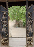 Wooden carved open door Royalty Free Stock Images