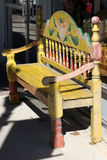 Wooden carved and painted bench in texas. Carved wooden bench on the street of Fredericksburg Texas USA stock images