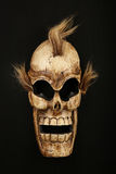 Wooden carved skull death mask on black Royalty Free Stock Photo
