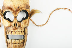 Wooden carved skull death mask on white. Handmade wooden carved creepy skull death joker mask on white background Royalty Free Stock Images