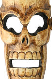 Wooden carved skull death mask on white Stock Photos