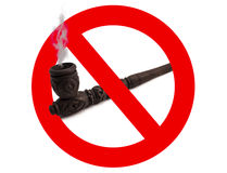 Wooden carved smoking pipe  with prohibitory sign. On white background Royalty Free Stock Photos