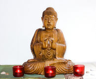 Wooden carvin buddha in meditation Royalty Free Stock Image