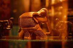 Wooden Carving Art of an Elephant. A wooden art, carving of an elephant kept in a showcase at a store in Aurangabad city Royalty Free Stock Photo