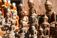 Wooden carving Buddhas souvenir. Royalty Free Stock Images