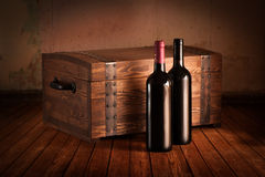 Wooden case and bottles Stock Photo