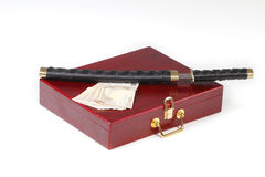 Wooden case, the sword and euro money. Red case, the black sword and euro money Royalty Free Stock Image