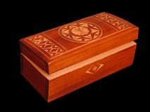 Wooden casket. With ornament over black background Stock Photos