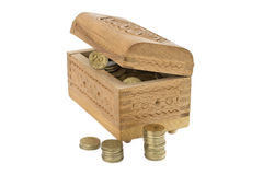 Wooden Casket with coins Royalty Free Stock Image