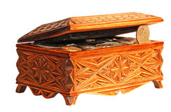 Wooden casket with coins Stock Image